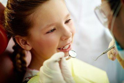 Young girl having checkup with her pediatric dentist at Trinity Family Dental in La Mesa, CA.